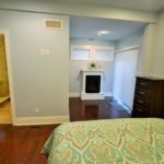 Sitting room and ensuite in large bedroom in fully furnished rental suite at 380 Dufferin Ave