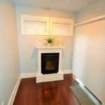 Fireplace and comfortable sitting room in fully furnished apartment at 380 Dufferin Ave, London, ON
