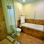 Ensuite bathroom with jetted tub in fully furnished rental suite, in 380 Dufferin Ave, London, ON