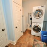 Laundry room in furnished rental suite at 380 Dufferin Ave, London, ON