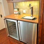 Built in wine cooler and beer tap in furnished apartment, at 380 Dufferin Ave, London, ON