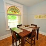Dining room in fully furnished apartment at 565 Princess Ave in London, ON, with historic charm