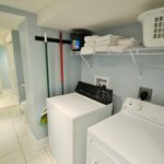 Laundry room in fully furnished rental suite at 565 Princess Ave, in London, ON