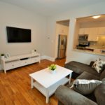Open concept kitchen and living room in fully furnished apartment, 565 Princess Ave, London, ON