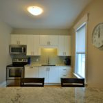 Breakfast bar and kitchen in fully furnished rental suite at 565 Princess Ave, London, ON