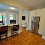 A large well-lit main floor and eat in kitchen in fully furnished apartment, at 565 Princess Ave, London, ON