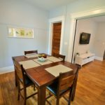 Dining room in fully furnished apartment at 565 Princess Ave in London, ON, with country charm