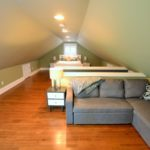 Sitting room and loft bedroom in furnished rental suite at 380 Dufferin Ave, London, ON