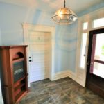Large well-lit entrance in fully furnished rental suite at 380 Dufferin Ave, London, ON