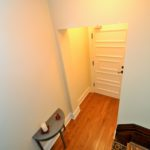 Front hall with hardwood floor, in furnished apartment at 380 Dufferin Ave, London, ON