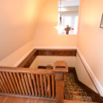 Carpeted stairwell in furnished rental suite at 380 Dufferin Ave, London, ON