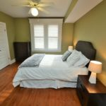 Large well-lit bedroom in furnished rental suite at 380 Dufferin Ave, London, ON