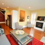 Living room with fireplace in fully furnished rental suite at 380 Dufferin Ave, London, ON