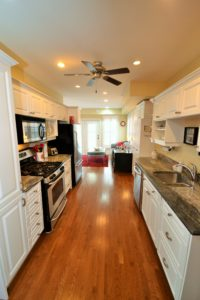 Modern kitchen in fully furnished rental suite at 380 Dufferin Ave, London, ON