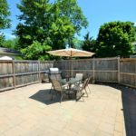 Large private brick courtyard of furnished rental suite at 565 Princess Ave, London, ON