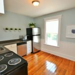 Large kitchen with modern appliances in furnished apartment at 565 Princess Ave, London, ON