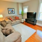 Large well-lit living room in fully furnished apartment at 565 Princess Ave, London, ON