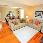 Open concept living room in fully furnished rental suite at 565 Princess Ave, London, ON