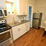 Modern kitchen in fully furnished bachelor suite at 572 Piccadilly Street, London, ON
