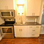 Modern kitchen in fully furnished bachelor apartment at 572 Piccadilly Street, London, ON