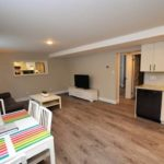 southdale road east furnished rental suite furnished living room image