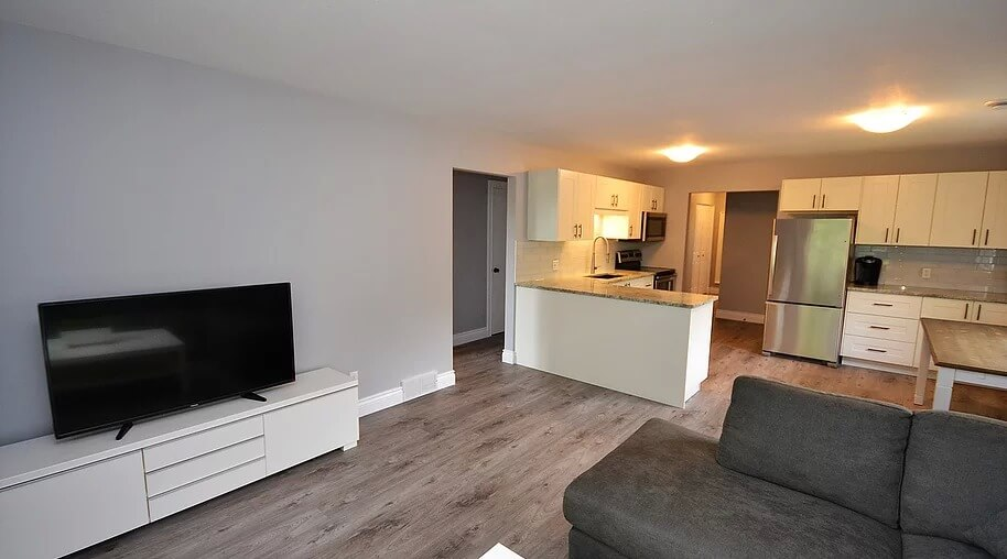 fully renovated open concept living room and kitchen in 3-642 Southdale Rd E in London Ontario